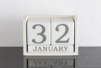 White block calendar present date 32 and month January - Extra day