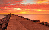 Sensational red sunrise skies at the Breakwall