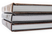 hardcover books lying on a white background