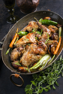 Rabbit with Vegetable and Mushrooms as top view in a Stewpot