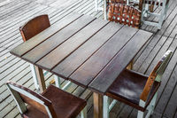 empty wooden table in restaurant with four empty chairs - vintage furniture