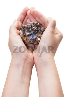 above view of zinc and lead mineral ore in handful