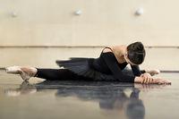 Ballerina posing in dance hall