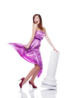 Young beautiful female wearing lilac dress, flirting, isolated on white