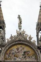 statue decorate the rooftop of the Basilica di San Marco (Saint Mark`s Basilica) in Venice