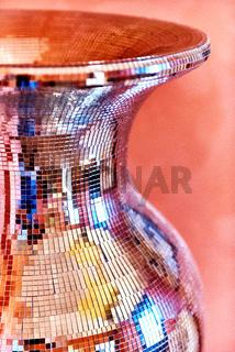 Part of a shiny mirror vase