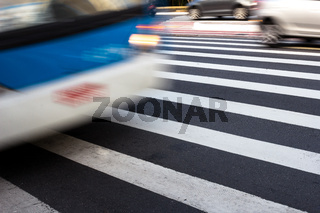 Bus passing over crosswalk during the day