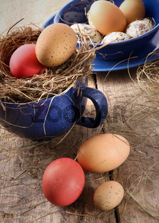 Easter eggs in blue enamel cup with straw