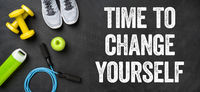 Fitness equipment on a dark background - Time to change yourself