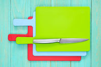 Set of cutting boards with a kitchen knife