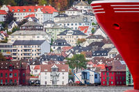 Red stern of a large ship in Bergen harbor
