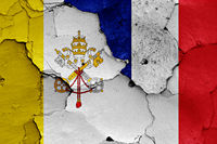 flag of Vatican and France painted on cracked wall