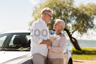 happy senior couple with car in summer