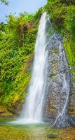 Beautiful Kaeng Nyui Waterfalls. Laos landscape. Vertical panorama
