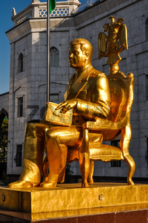 Golden man with book