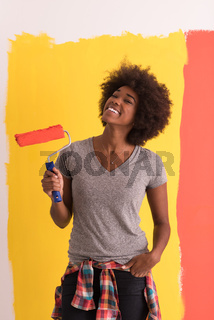 black woman painting wall