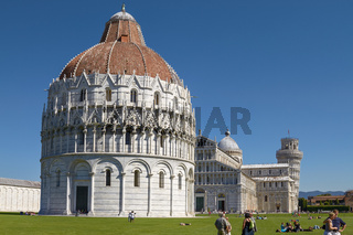 PISA, ITALY - SEPTEMBER 29, 2010: Tourists Enjoying Sunny Day in Front Of Baptistery at Leaning Tower of Pisa in Tuscany, Italy