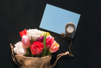 Flowers and a pocket clock on a paper note