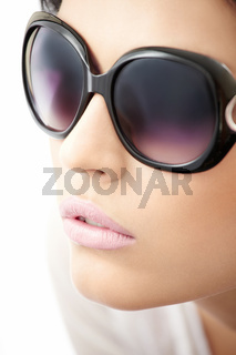 Portrait of beauty in big sun glasses