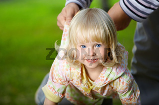Amusing small blonde girl with blue eyes