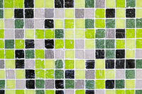 Hintergrund aus grünen, schwarzen und grauen Mosaiksteinchen