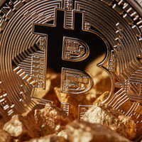 Closeup of golden Bitcoin Coin and mound of gold. Bitcoin cryptocurrency.