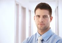 Goodlooking businessman standing in hallway