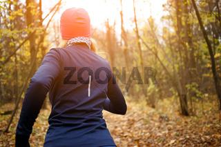 Blonde sportswoman jogging in morning