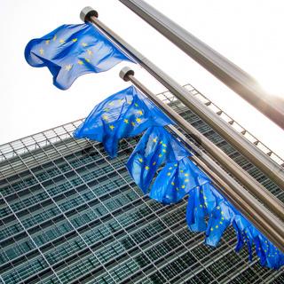 EU flag waving in front of European Parliament