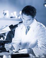 Life science researcher working in scientific laboratory.