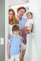 Happy family in doorway