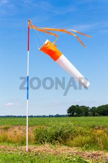 Wind meter in rural area with blue sky