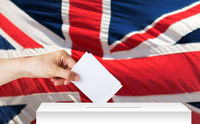 hand of englishman with ballot and box on election