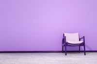 a chair in an empty room