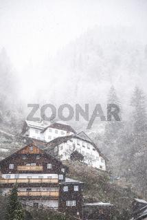 Alpine village on a snowing day