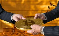 Three traders hands holding large bitcoin