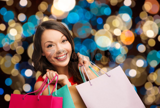 smiling woman with colorful shopping bags
