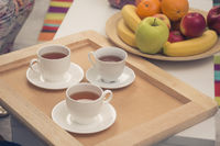Three cups of tea on tray