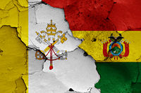 flag of Vatican and Bolivia painted on cracked wall