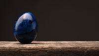 Blue Colored Easter egg on wood