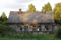 old wooden village abandoned house with broken glass in windows, Russia.