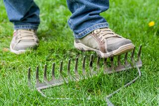 A man stepping accidentally on a rake