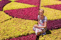 Dutch woman as tourist between colorful plants