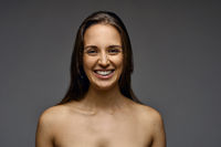 Attractive smiling woman with bare shoulders