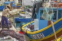 Fishermen Working On Their Nets, Marsaxlokk Village, Malta