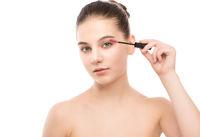 Eye make up apply. Mascara applying closeup, long lashes. makeup brush. Isolated.