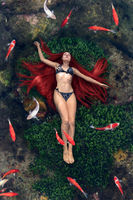 Young woman floating in water