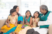 Happy Indian family indoors portrait