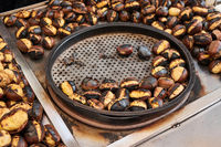 Grilled chestnuts for sale on street