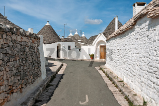 Trulli houses in a street of Alberobello, Puglia, Italy